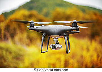 Dark drone in flight.