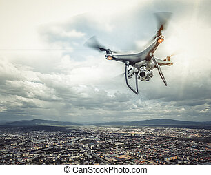 The drone is flying over the city.
