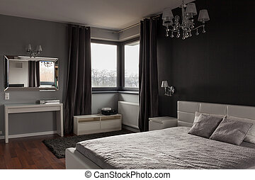 Dark expensive bedroom with black and grey walls