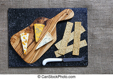 Dark Food - Blue cheeses on olive wood board