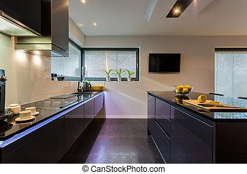 Dark furniture in kitchen - View of dark furniture in white...