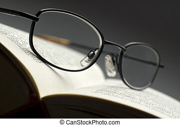 book - dark glasses on a book close up