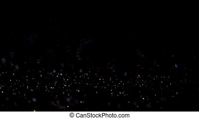 Dark glitter magic background. Defocused light and free...