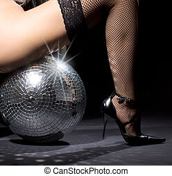 dark glitterball dance - party dancer girl in fishnet...