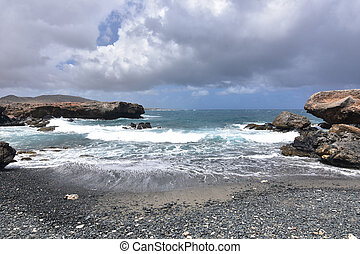 Dark Gray Skies Above the Black Sand Stone Beach in Aruba