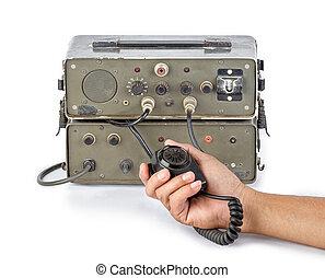 dark green amateur ham radio holding in hand on white...