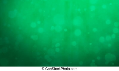 Dark green background with floating particles