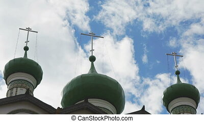 Dark green domes with crosses of Orthodox Church