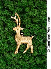 Christmas reindeer on dark green moss background