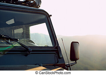 Dark green off-road car in the mountains