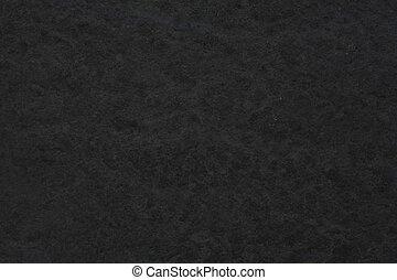 Dark grey background with rough stone texture
