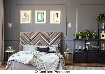 Dark grey bedroom interior with wainscoting on the wall,...
