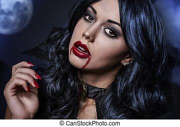 Dark hair female vampire at night