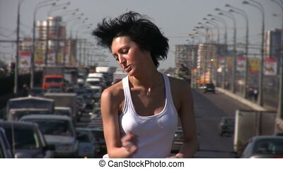 girl dancing on highway middle - dark hair girl dancing on...