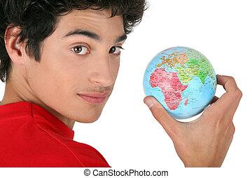 dark-haired boy holding globe