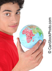 Dark-haired boy with globe