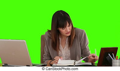 Dark-haired businesswoman looking at her diary