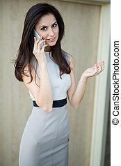 Dark-haired girl in a dress
