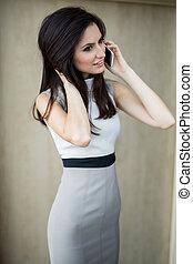 Dark-haired girl in a light dress