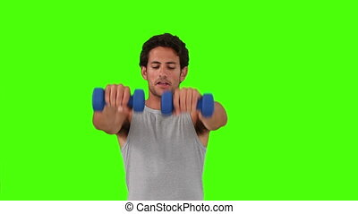 Dark-haired man in sportswear with dumbbells