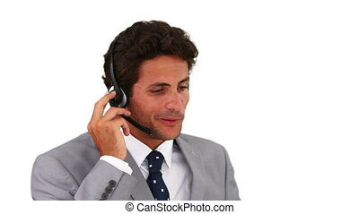 Dark-haired man talking on the phone in a call center