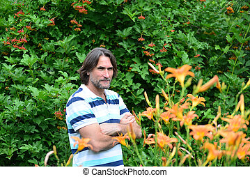 dark-haired man with a beard in nature