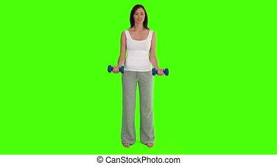 Dark-haired woman doing bodybuilding exercises