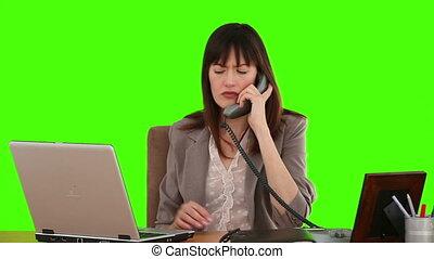 Dark-haired woman having a phone call