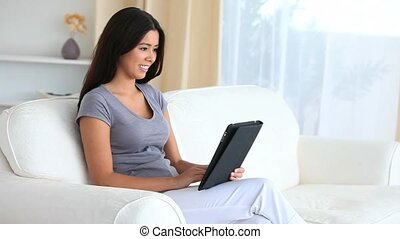 Dark-haired woman with a tablet