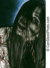 dark hairs - Close-up portrait of a bloodthirsty gnarling...
