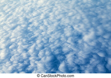 blue sky with small white clouds