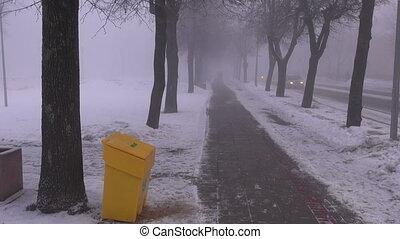 morning fog in snowy street - dark heavy morning fog in...