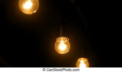 dark interior room with light bulbs