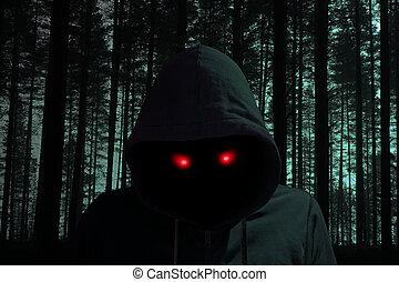 Dark man with hoddie in black forest red eyes
