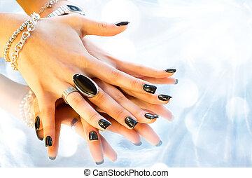 dark manicure with silver bijoux