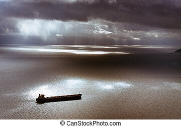 Dark moody sky and Mediterranean Sea with ship leaving...