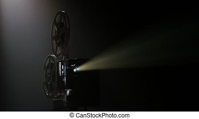 Dark movie theater. Projector illuminated by lights broadcasts a movies