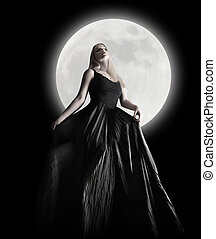 Dark Night Moon Girl with Black Dress - A woman is wearing a...