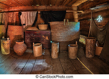 Dark old wooden barn with utensil. Ukraine