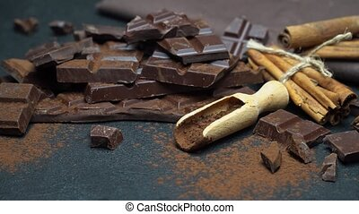 Dark or milk organic chocolate pieces and cocoa powder on ...