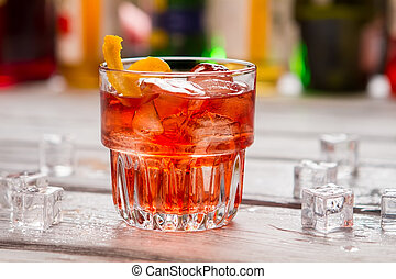 Dark orange drink in glass.