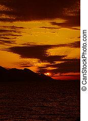 dark orange sunset at mountain landscape