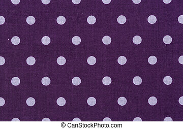 Dark orchid background with white polka dots pattern.