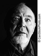 dark portrait of elderly man
