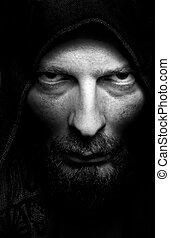 Dark portrait of scary evil sinister bearded man