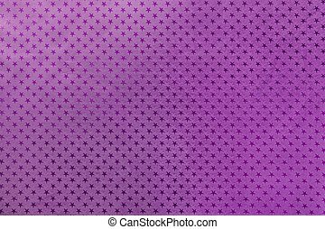 Dark purple background from metal foil paper with a stars pattern