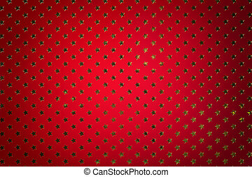Dark red background from metal foil paper with a golden stars pattern.