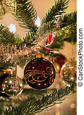 Dark red decorated ball in christmas tree