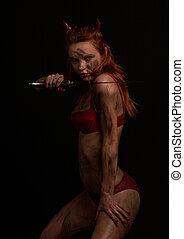 dark red devil girl with a knife over black