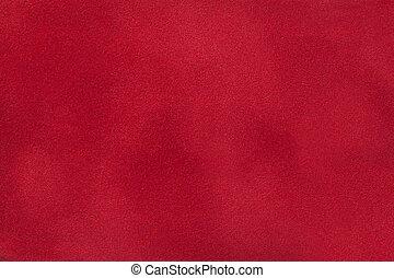 Dark red matte background of suede fabric, closeup.